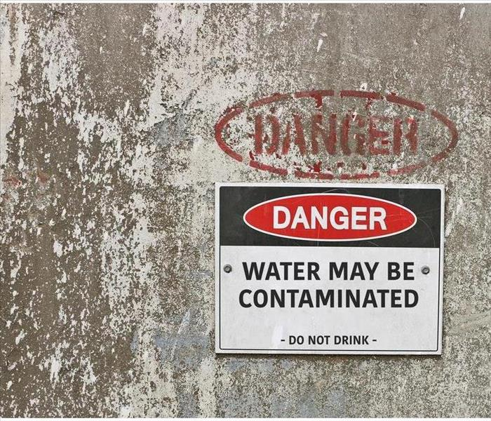 Water May Be Contaminated warning sign