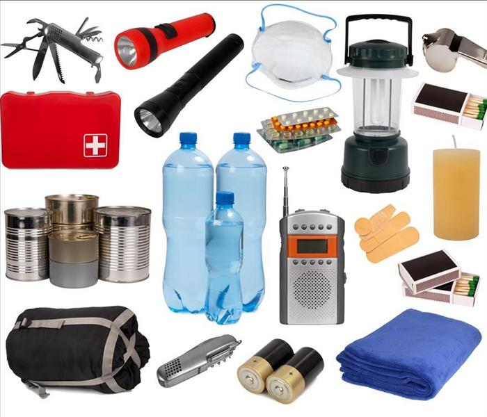 An emergency kit, it has water bottles, flashlights, batteries, medicine, matches, sleeping bag and blanket