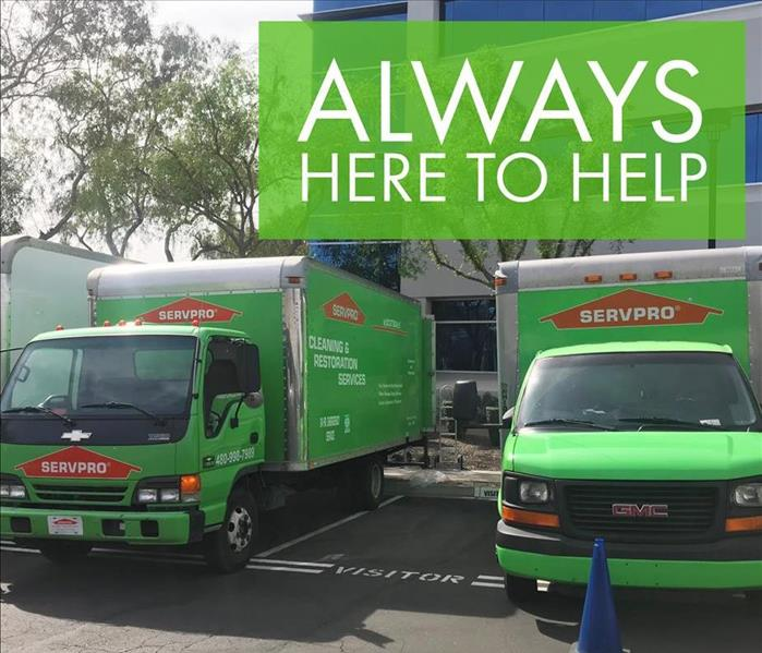 SERVPRO trucks in front of building